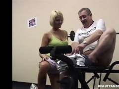 breasty blond teen engulf an old rod in gym
