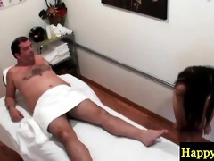 youthful oriental masseuse stroking an old lad