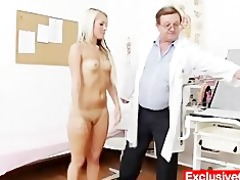 old doctor checks youthful golden-haired beauty